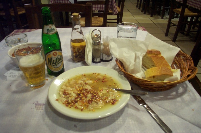 Greek patsas, here served with dried chili peppers and a Greek beer Mythos.
