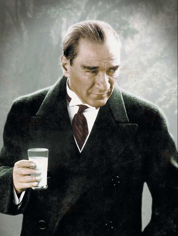 Atatürk in a common pose with a full glass of Turkish raki.