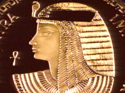 Portrait of Cleopatra in the classic Egyptian style from the side.