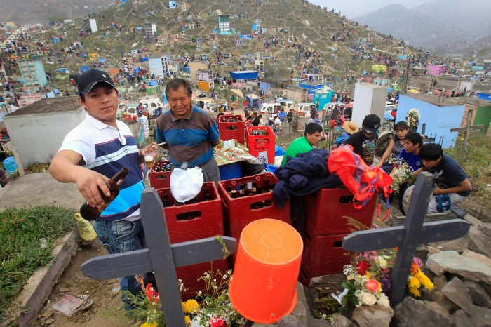 Many people in Peru come to the cemetery to have  a drink with their deceased loved ones now and then.