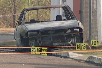 The burned out car in which the dead body was found.