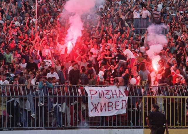 "Banner by fans of Red Star Belgrade for their player and notorious drinker Zoran Riznić saying ""Rizna cheers""."
