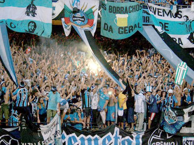 These are fans from Gremio (Brazil). One of their fanclubs is named 'Borrachos da Geral', which means the drunks of the general.