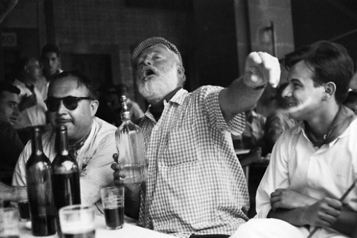 Ernest Hemingway (middle) in a classic pose, drinking in Cuba where he would live in the 50's before the Communist revolution.
