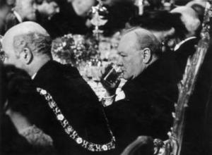 Churchill in a classic pose, having a drink.