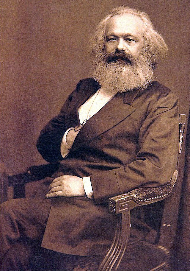Karl Marx posing and - at least we suspect - reaching for a flask with alcohol.
