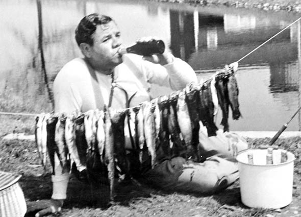 Babe Ruth in a classic pose, enjoying the good life on the waterside.