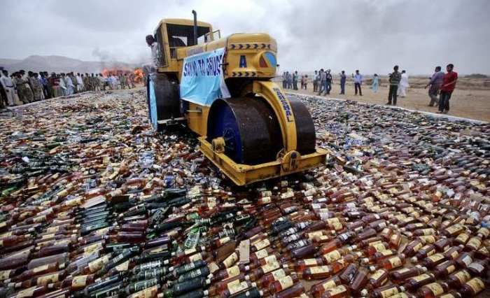 Many fine bottles of alcohol are destroyed in Pakistan after death threats by the Taliban.