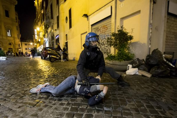 Police violence in Rome against Feyenoord fans.