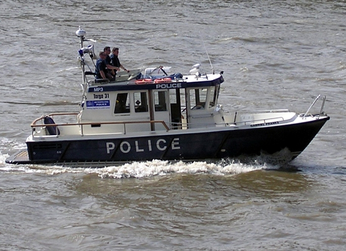 Who doesn't  dream about taking a police patrol boat for a drunken joy ride?