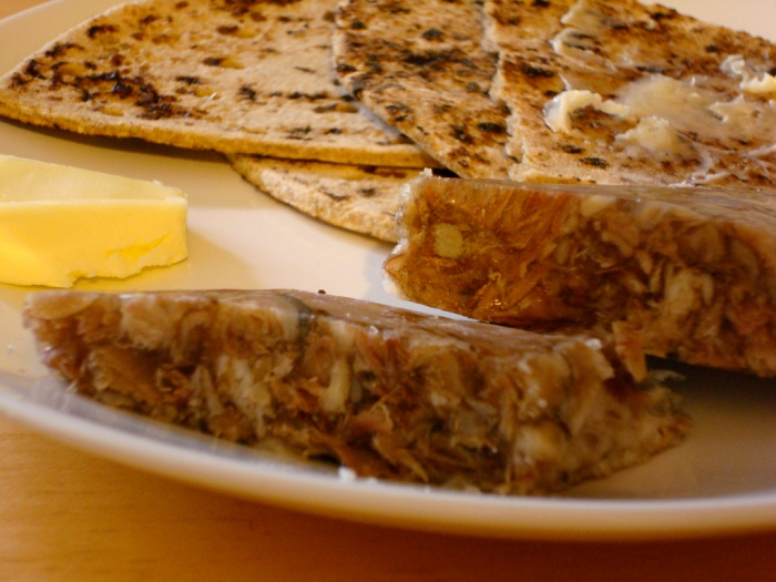 The traditional Icelandic hangover cure sviðasulta, served with  Flatbrauð (flat bread) and butter.