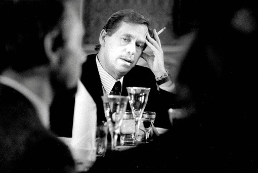 Czech national hero Václav Havel in a classic pose during a meeting; drinking and smoking.