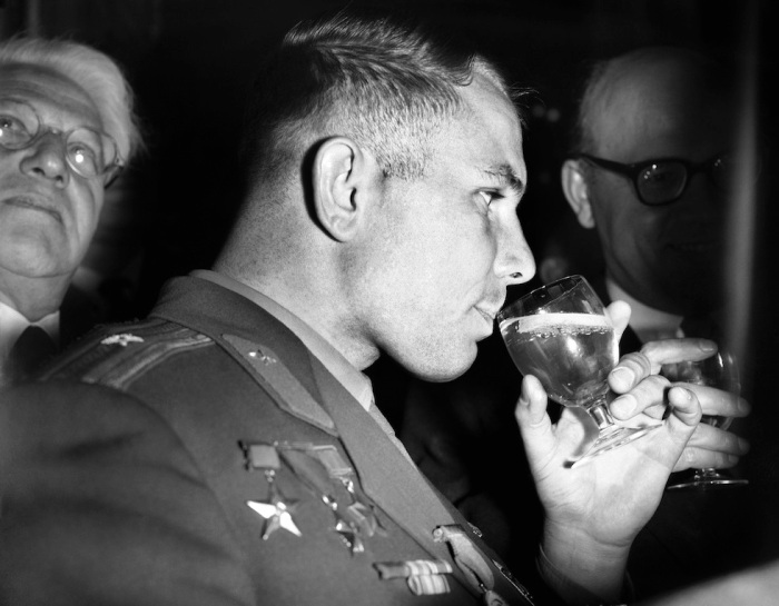 Yuri Gagarin sipping on booze on one of his many tours after his trip into Space.