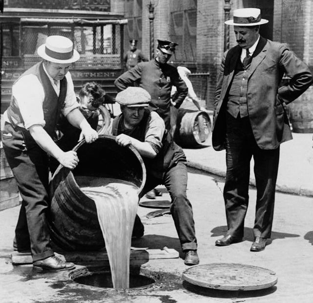 The twisted American alcohol approach portraited well: good beer is dumped in the sewer in the prohibition days.