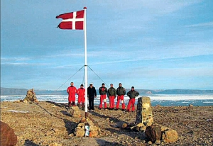 Danish soldiers take back Hans Island.